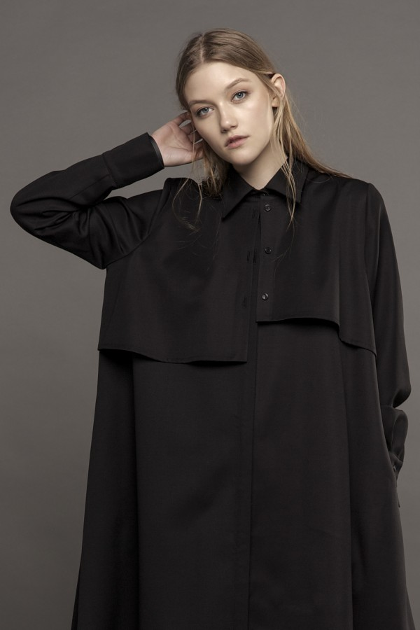 Fluid black shirt with pocket detail at the back